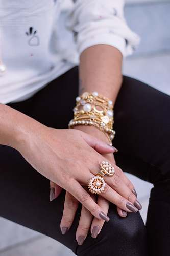 person two white pearl encrusted gold-colored rings people
