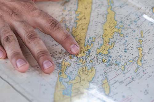 hand person holding blue and green map point