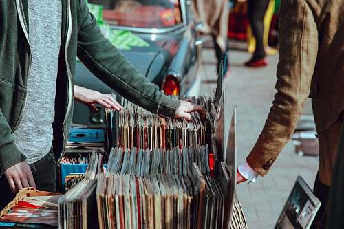 records person selling vinyl album in street lewis cubitt square