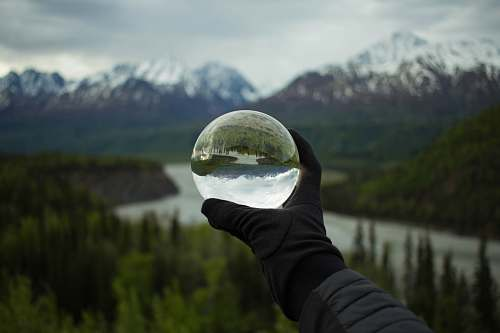 human person holding glass globe person