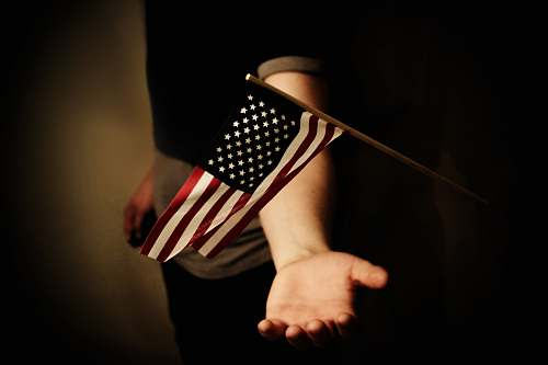 human person with open palms below USA flaglet person