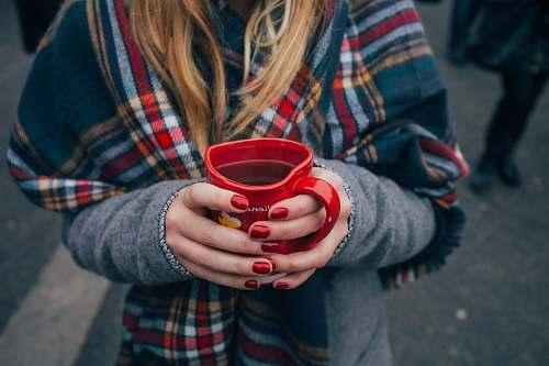 human woman holding a mug mug