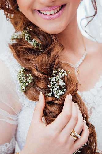 wedding woman holding her hair with flower hair
