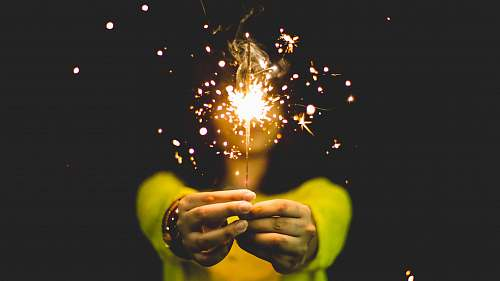 woman woman wearing green shirt holding sparkler spark