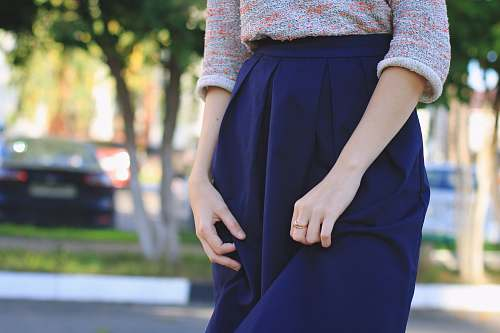 people close-up photography of woman wears blue skirt at daytime girl