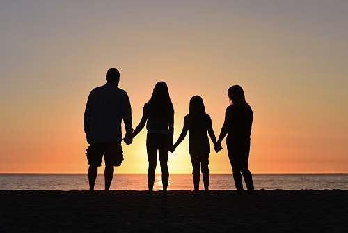 human four people on seashore people