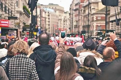 people group of people in street watching parade london