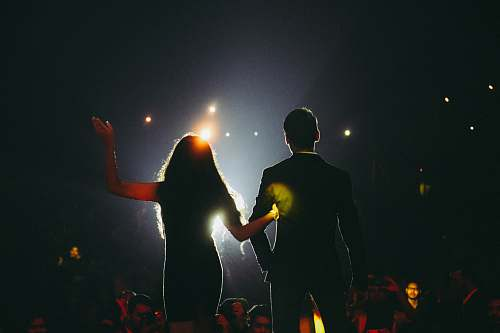human man and woman on stage flare