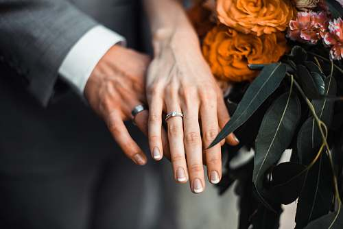 human man and woman wearing silver-colored rings people