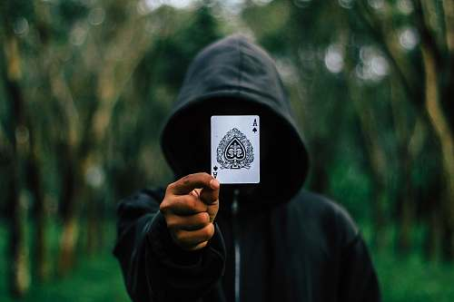 people man holding Ace of Spade card human