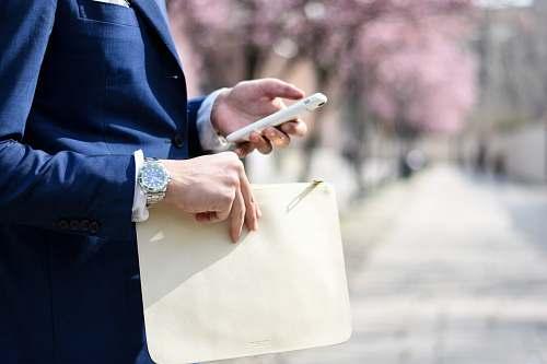 human man holding envelope taken at daytime people
