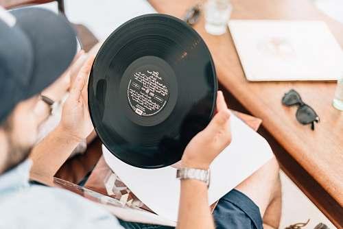 human man holding vinyl record people
