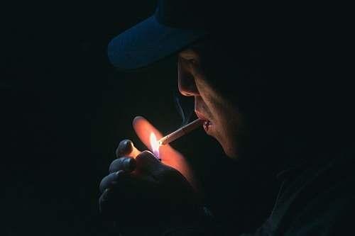 people man lighting his cigarette human