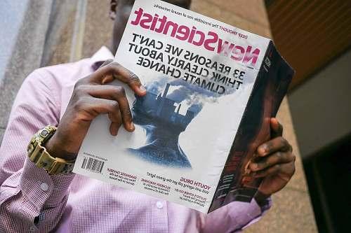 human man reading New Scientist book people