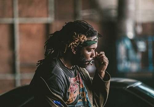 people man sitting smoking cigarette human