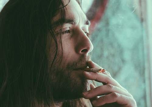 people man smoking red cigarette human