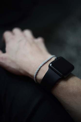 human man wearing space gray Apple Watch with black Sports Band people