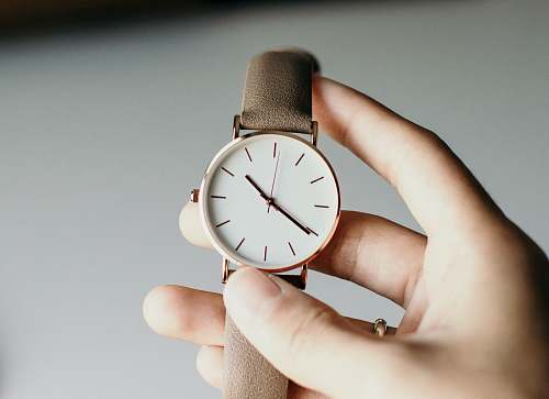 human person holding analog watch people