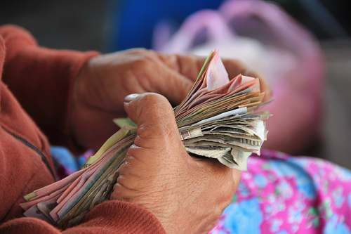 vietnam person holding banknotes money