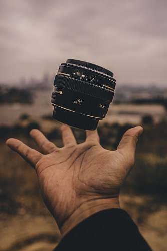 human person holding camera lens people