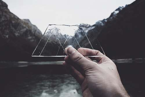 human person holding clear glass panel new zealand