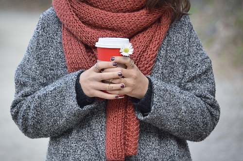 people person holding red and white disposable cup human