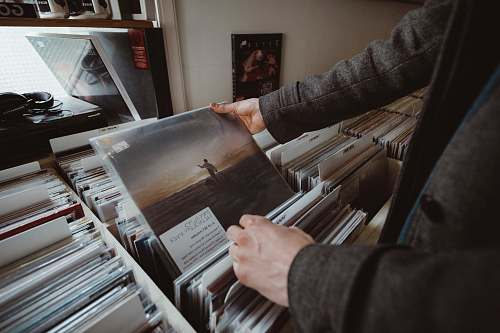 human person holding vinyl album people