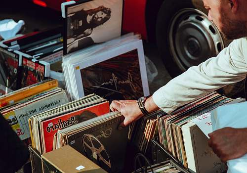 music person holding vinyl records vintage