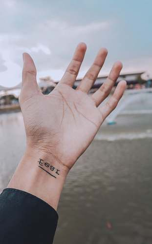 photo human person showing right wrist with fear tattoo hand free for commercial use images