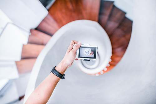 people person taking picture of white spiral staircase human