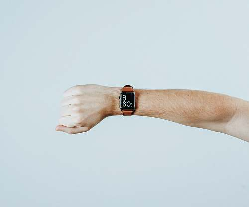 minimal person wearing Apple watch finger