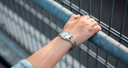 human round silver-colored analog watch with link bracelet wristwatch