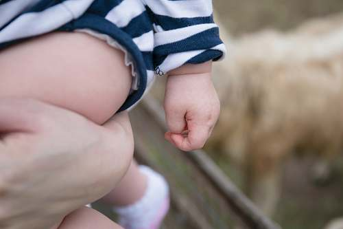 human selective focus photography of child finger