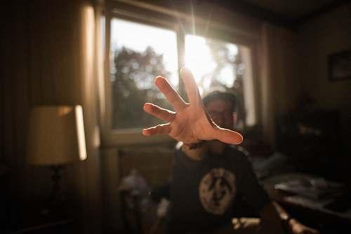 hand shallow focus photography of man hand clock