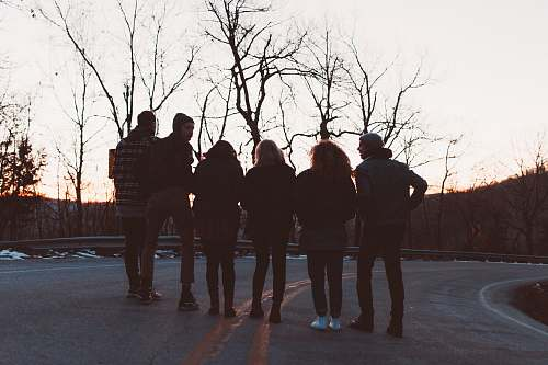 human silhouette photography of six people standing on road pedestrian