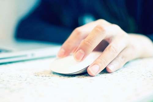 human white Apple Magic mouse hand