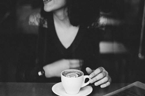 human woman holding coffee mug black-and-white