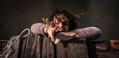 human woman holding on brown wooden plank nashville