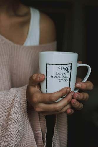 human woman holding white ceramic mug people