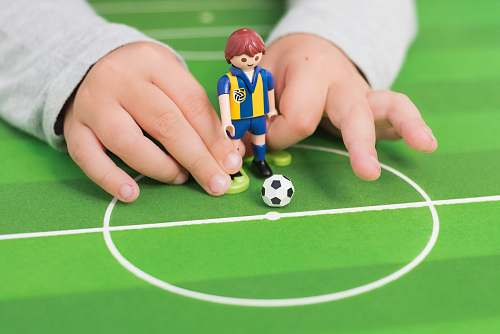 toy person playing minifig soccer game