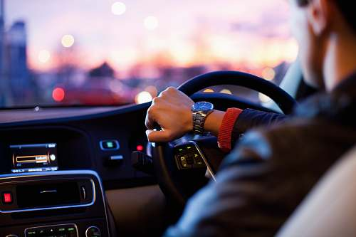 driving man driving a car wearing wrist watch car