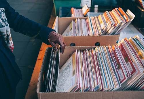 music person touching book box shopping
