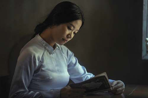 people woman wearing gray long-sleeved tops reading book reading