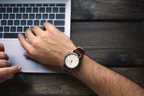 work person wearing brown and white watch hand