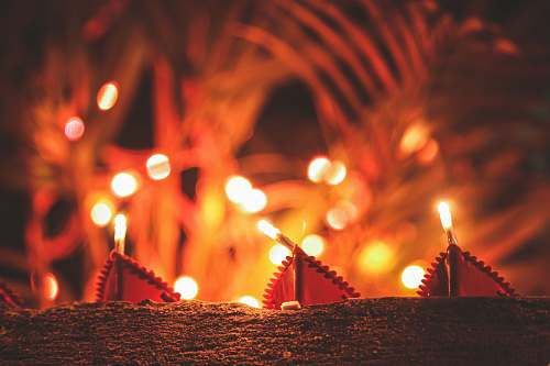photo fire lit candles at night diwali free for commercial use images