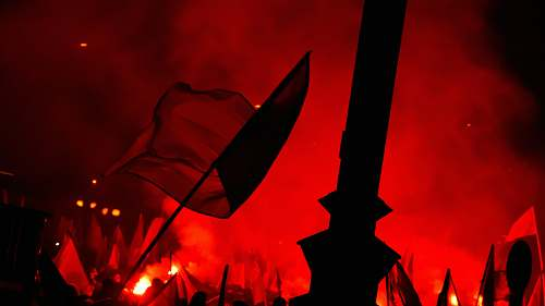 photo poland people raising flags near bonfire red free for commercial use images