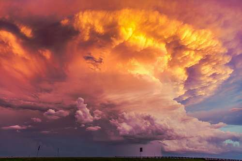 sky plume of orange clouds at sunset weather
