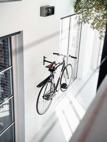 bike black city bike mounted in wall bicycle