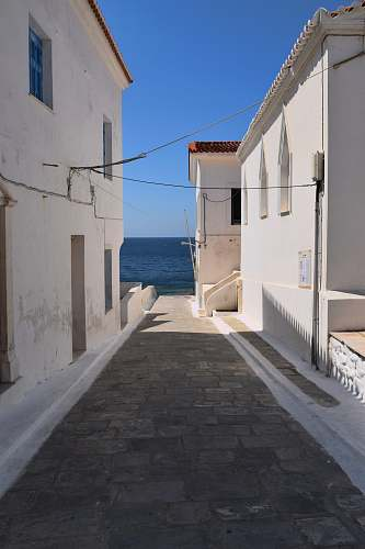 greece empty pathway with beige concrete house summer