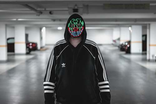 clothing man wearing black and white adidas jacket wearing multicolored mask automobile